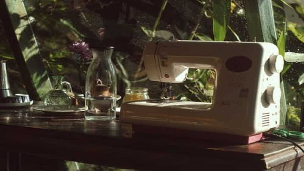 A sewing machine on a cabinet