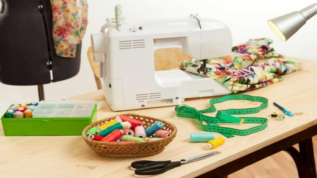 A sewing machine and accessories on a table